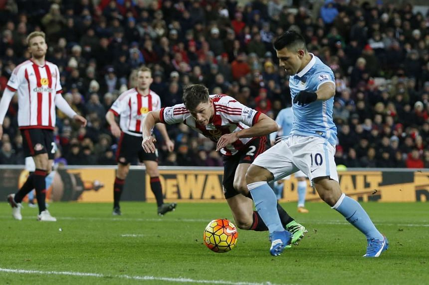 Sergio Aguero scores the only goal in the English Premier League football match between Sunderland and Manchester City.