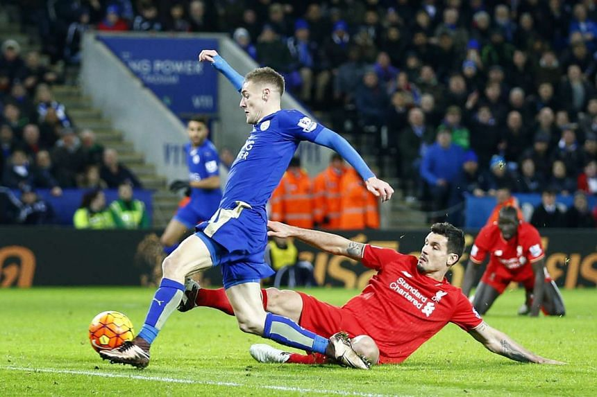 Jamie Vardy (left) scores the second goal for Leicester City.