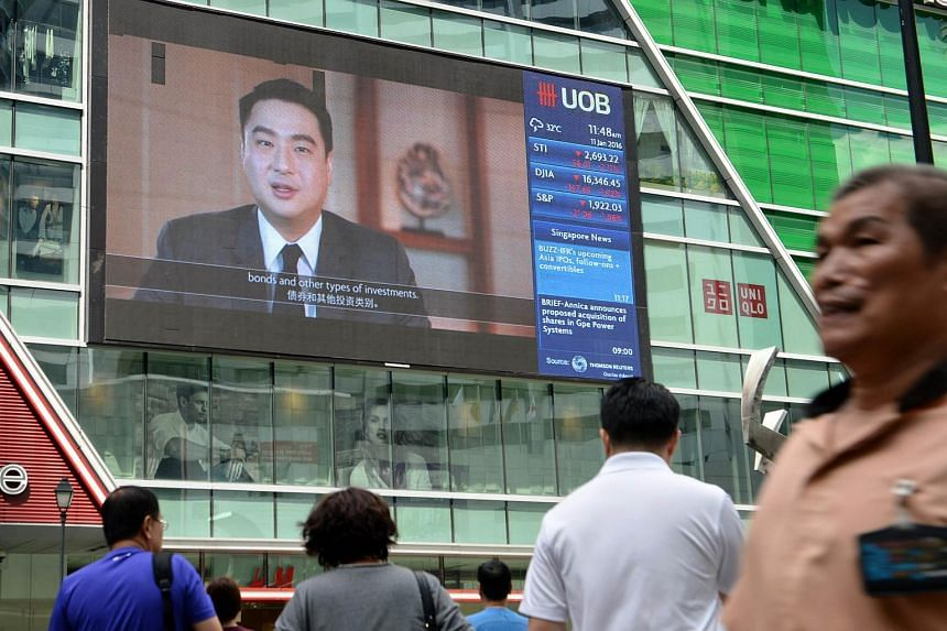 A big screen displays information on the stock index at the Raffles Place financial district on Jan 11, 2016.