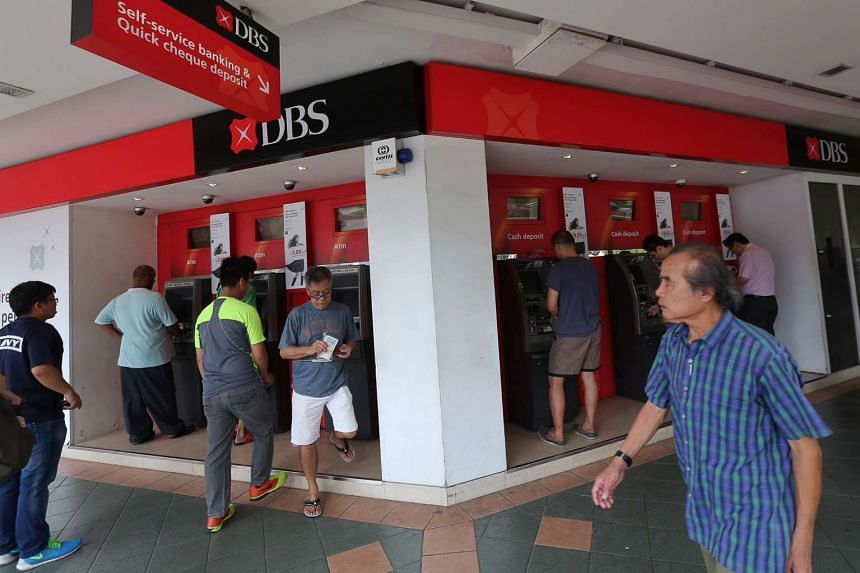 Members of the public depositing cash at DBS ATMs in Bedok Town Centre on Feb 4, 2016.