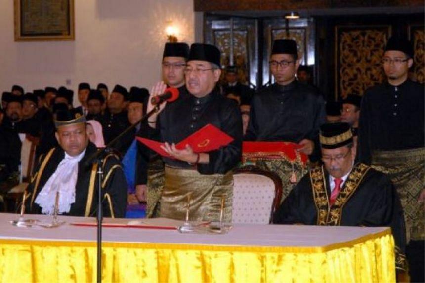 Datuk Seri Ahmad Bashah Md Hanipah (centre) was sworn in on Thursday (Feb 4) as Kedah Menteri Besar.
