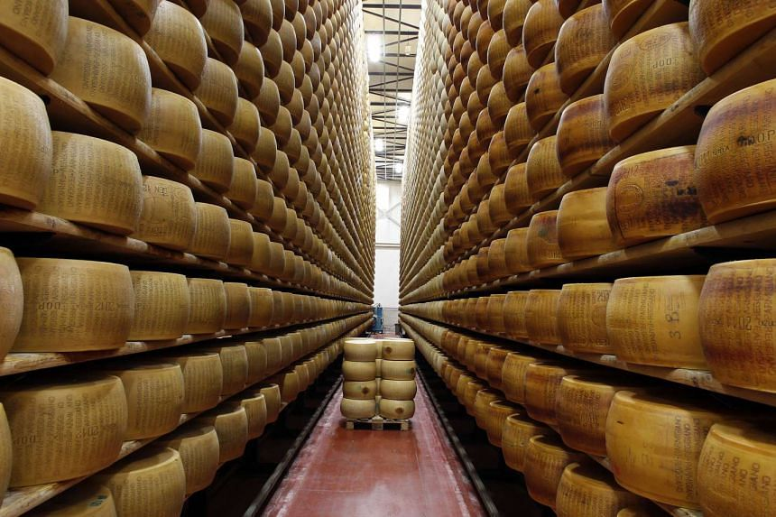 A storage area for Parmesan cheese wheels is pictured at a warehouse owned by Credito Emiliano bank.