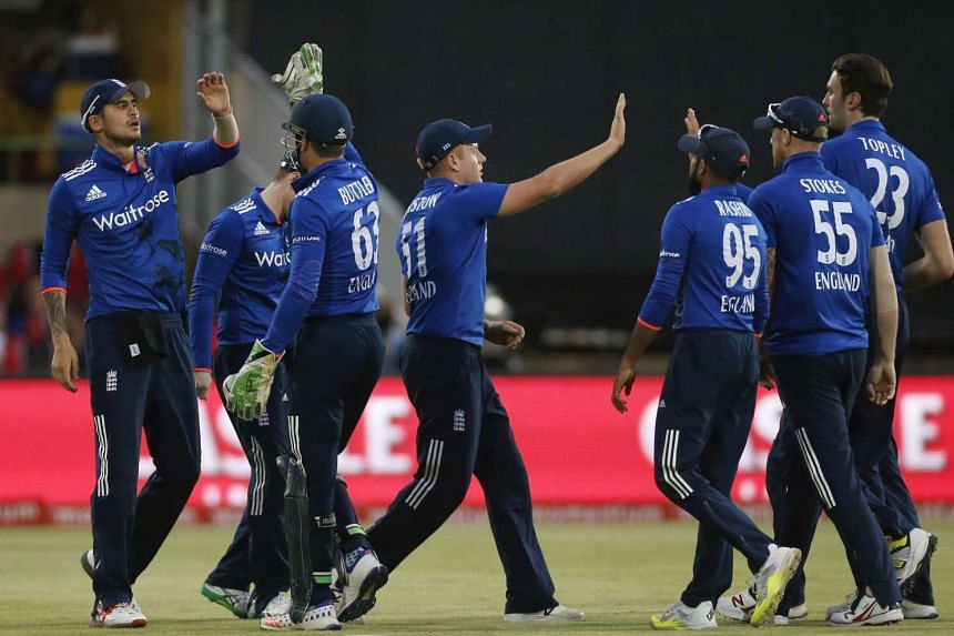 England cricket players celebrate the dismissal of South Africa's captain AB de Villiers during the first ODI cricket match in Bloemfontein, South Africa, on Feb 3, 2016.