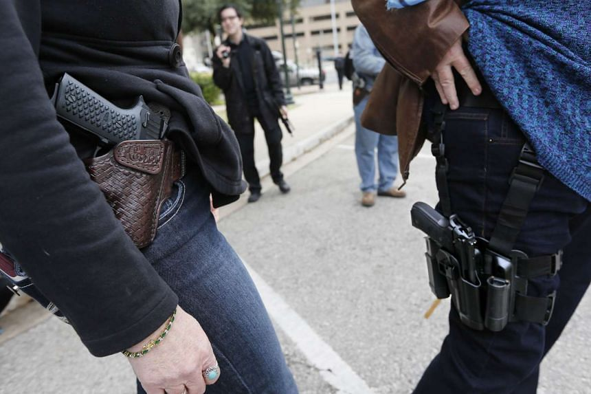 Florida could be the next state to allow gun owners to openly carry their firearms, following Texas (above), which passed the law on Jan 1, 2016.