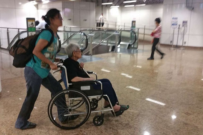 A woman's leg was stuck in the train gap at Chinatown MRT station on Feb 3, 2016. She was wheeling her mother out of the train.