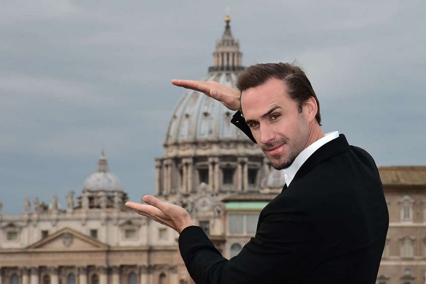 British actor Joseph Fiennes poses with the Vatican in the background during a photocall for the movie Risen.