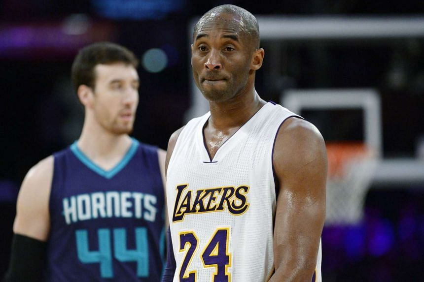 Kobe Bryant (right) of the Los Angeles Lakers reacts during the second half of the basketball game against Charlotte Hornets on Jan 31, 2016, in Los Angeles.