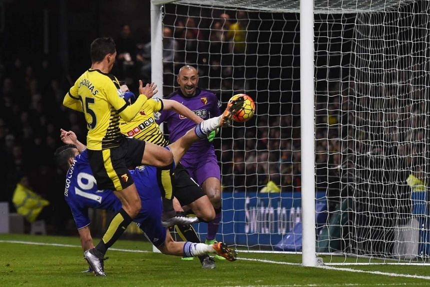Chelsea's Diego Costa attempts to score against Watford's goalkeeper Heurelho Gomes on Feb 3, 2016.