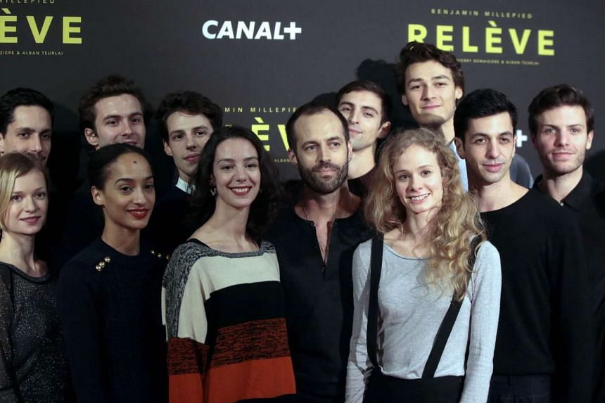 Millepied (centre) poses with his dancers on Nov 25, 2015, in Paris.