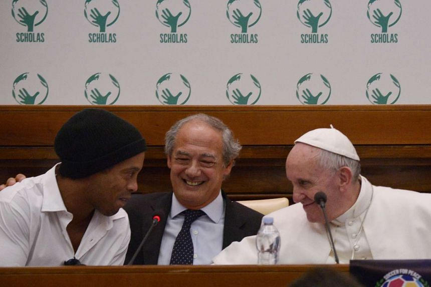 "Brazilian football star Ronaldinho (left) meets Pope Francis and the directors of ""Scholas Occurentes"" organisation."