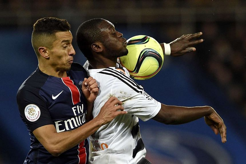 Paris Saint-Germain's Brazilian defender Marquinhos (left) vies with Lorient's Ghanaian forward Abdul Waris during the French L1 football match on Feb 3, 2016, at the Parc des Princes stadium in Paris.