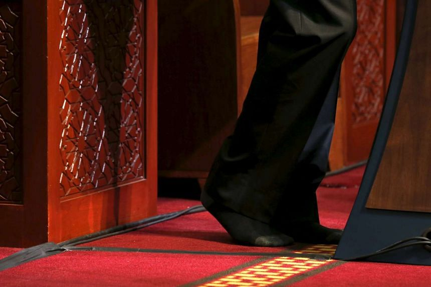 Mr Obama goes without shoes, out of deference, as he delivers remarks at the Maryland mosque.