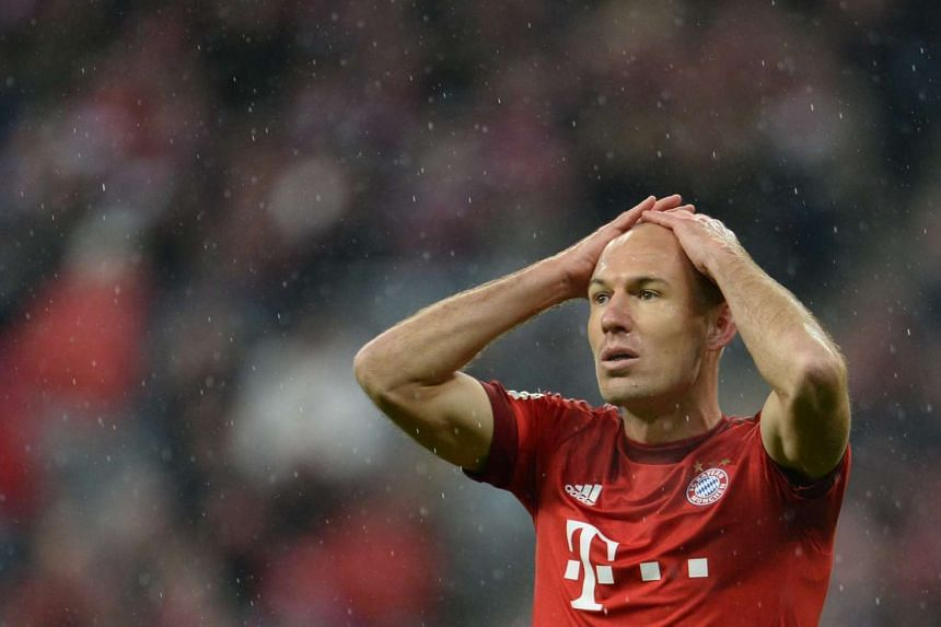 Arjen Robben reacts after a missed opportunity during the German Bundesliga football match between Bayern Munich and Hoffenheim.