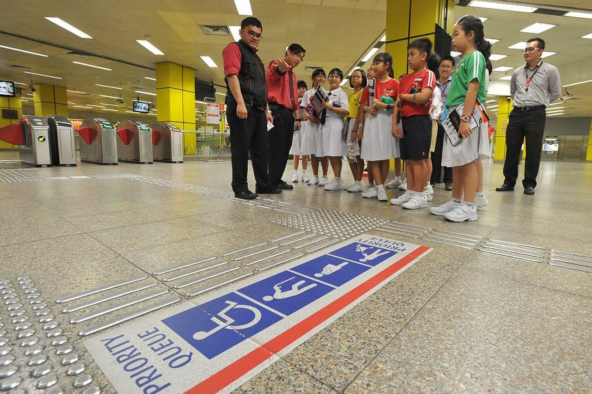 Pupils from Pei Chun Public School (above) being taught about train station operations during a training session at Toa Payoh MRT station last month. The SMRT's Adopt-a-Station initiative, which began in September 2014 and currently has 21 schools taking