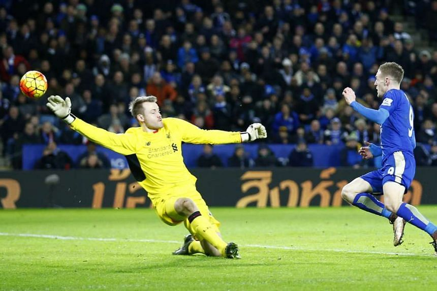 Leicester's Jamie Vardy (in blue) scoring past Simon Mignolet for his second goal in the 2-0 win over Liverpool. It was the 18th goal of the season for Vardy, who is currently the Premier League's top scorer.