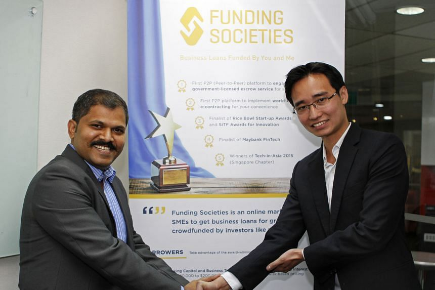 Mr Karuppaiah Palani, who owns an Indian restaurant, with Mr Teo, co-founder of crowdfunding platform Funding Societies, which gave the SME a loan.