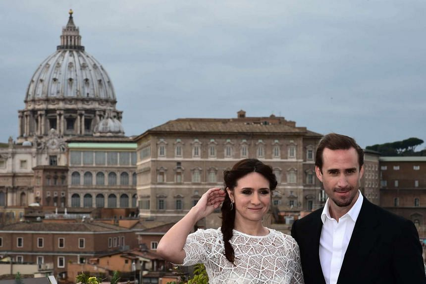 British actor Joseph Fiennes poses with co-star Maria Botto with the Vatican in the background at the Risen photocall.