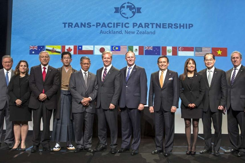 New Zealand Prime Minister John Key (sixth from right) and Ministerial Representatives from multiple countries pose for a photograph after signing the Trans-Pacific Partnership.