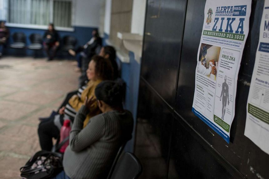 A Zika awareness poster is seen in a clinic where pregnant patients are waiting to see the doctor.