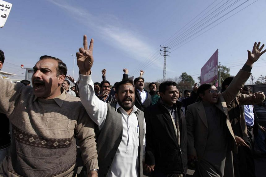 Employees of Pakistan International Airlines (PIA) chant slogans during a protest outside the Benazir International airport in Islamabad, Pakistan.