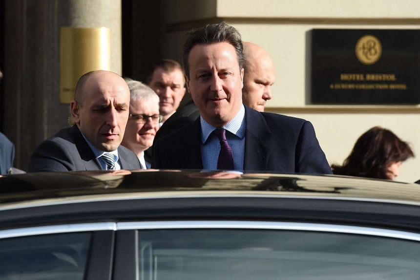 British Prime Minister David Cameron (centre) after a meeting with Law and Justice party leader Jaroslaw Kaczynski (not seen) in Warsaw, Poland on Feb 5, 2016.