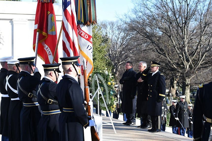 (From left) US Secretary of Defence Ashton Carter, Australian PM Malcolm Turnbull and escort Major-General Bradley A. Becker at the Tomb of the Unknowns in Arlington National Cemetery in Virginia on Jan 18.