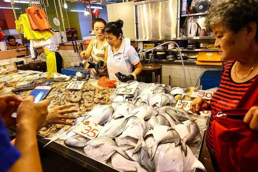 Pomfret is a popular item for reunion dinners. At this market stall in Chinatown, they were $35 each. The silver pomfret - deemed the best-tasting of the breed and favoured for its auspicious name - is much pricier.