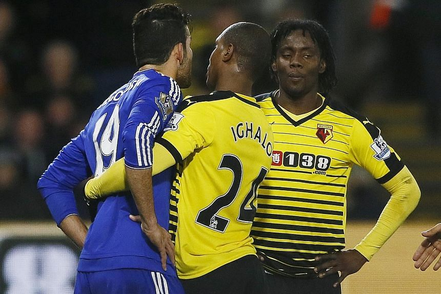 Odion Ighalo trying to intervene after Chelsea's Diego Costa (left) tussled with Juan Carlos Paredes, who was booked later.