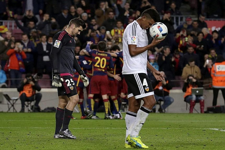 Valencia goalkeeper Matthew Ryan and defender Aderlan Santos down in the dumps after conceding their sixth goal during the King's Cup semi-final first-leg match at the Nou Camp. It ended 7-0 to Barcelona.