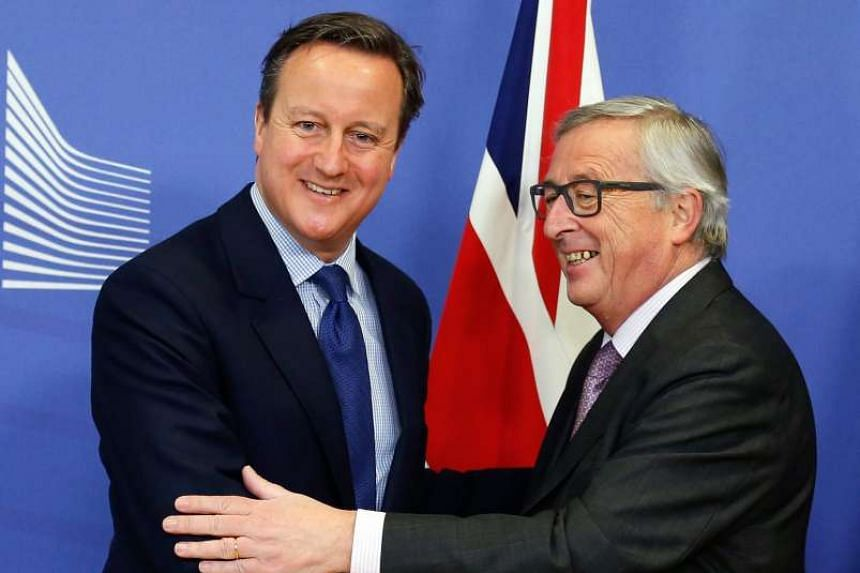 European Commission President Jean-Claude Juncker (right) meeting British Prime Minister David Cameron.