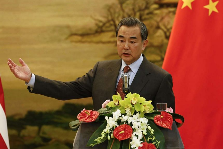 Chinese Foreign Minister Wang Yi speaking at press conference in Beijing on Jan 27.