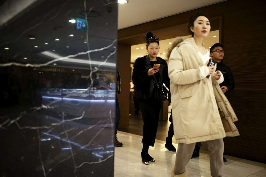 Chinese tourists at a Lotte duty free shop in central Seoul on Feb 2.