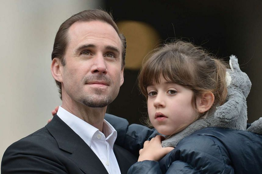 Fiennes stands with his daughter in St Peter's square before Pope Francis' weekly general audience.