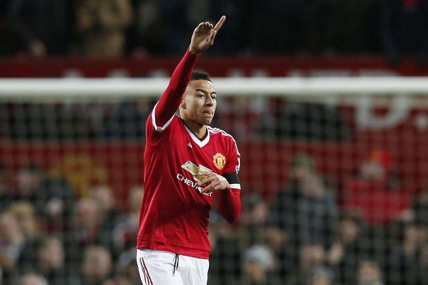 Jesse Lingard celebrates scoring the first goal for Manchester United  against Stoke City on Feb 2, 2016.