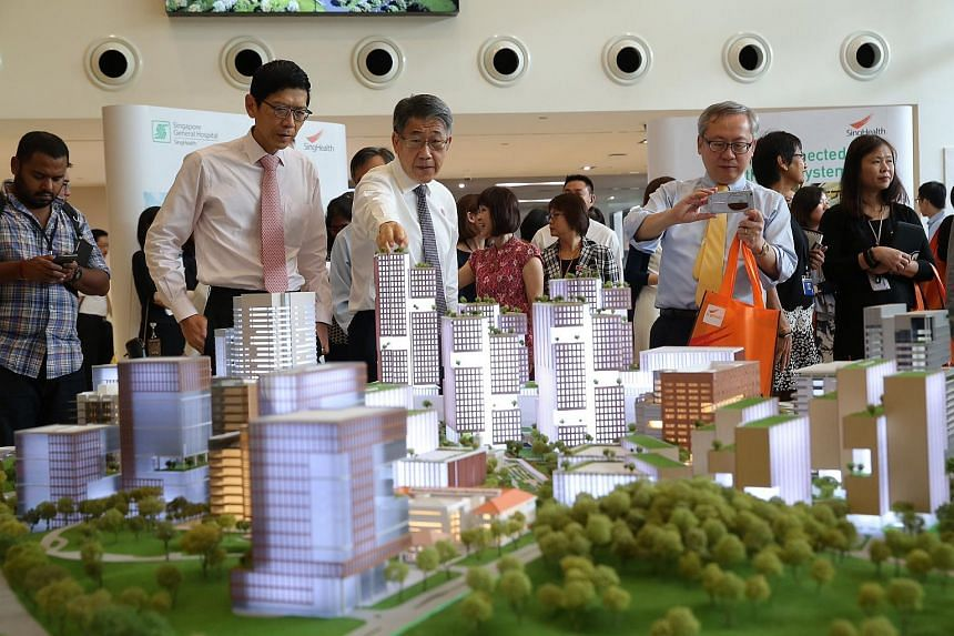 Guests viewing a model of SGH's new masterplan, which was unveiled on Feb 5.