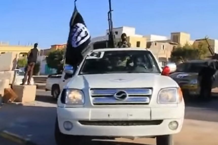 A screenshot from an online video said to show a convoy of ISIS militants entering Sirte.