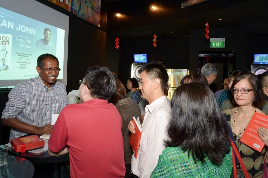 Former Straits Times deputy editor Alan John (left) with attendees at the launch of his book at Shanghai Dolly in River Valley Road last night. More than 110 people attended the Singapore Press Club event.