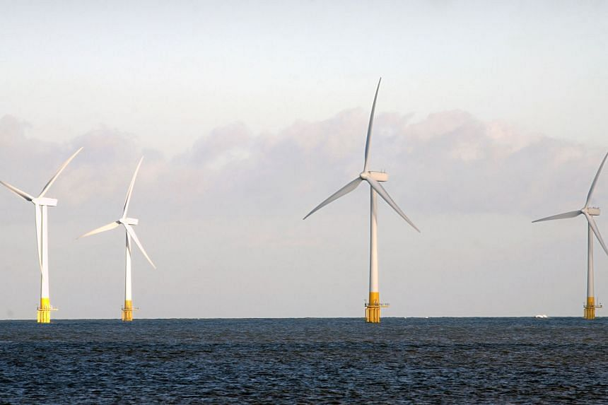 Wind turbines stand off-shore at Scroby Sands, Great Yarmouth in Norfolk, England. Britain's geographic location and strong wind conditions make it a prime candidate for hosting wind farms. The upcoming Hornsea Project One will be built 120km off the coas