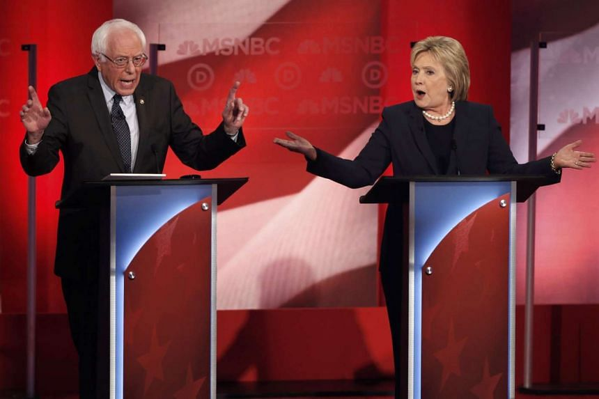 Mr Bernie Sanders and Mrs Hillary Clinton speak simultaneously during the Democratic presidential candidates debate in Durham, New Hampshire, on Feb 4, 2016.