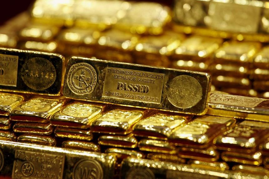 Seven Singaporeans were charged in Taiwan for using a gold buyback scheme to cheat customers.