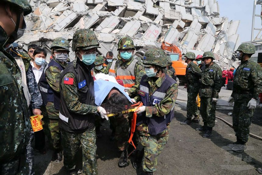 Soldiers moving a person to hospital in Tainan City, south Taiwan, Taiwan, Feb 6, 2016