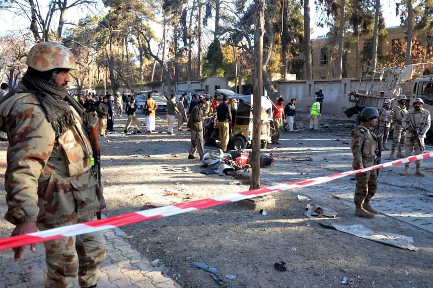 Security officials inspect the scene of a bomb blast in Quetta, Pakistan on Feb 6, 2016.