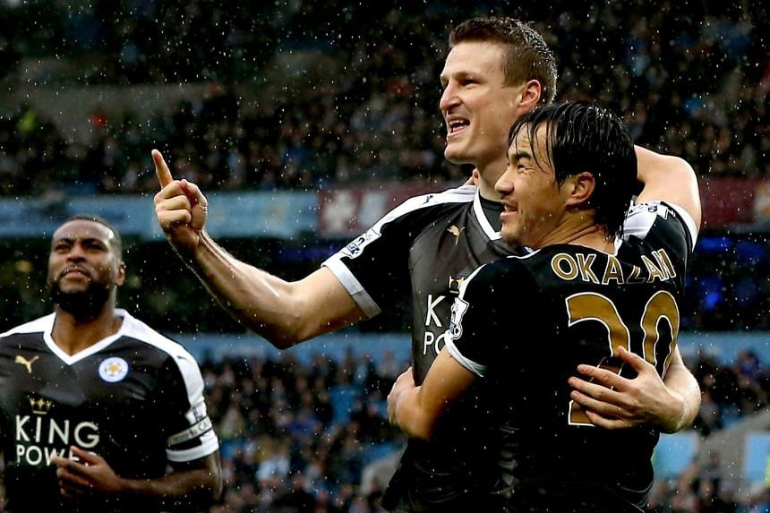 Leicester City's Robert Huth and Shinji Okazaki celebrating after Huth's first goal against Manchester City.