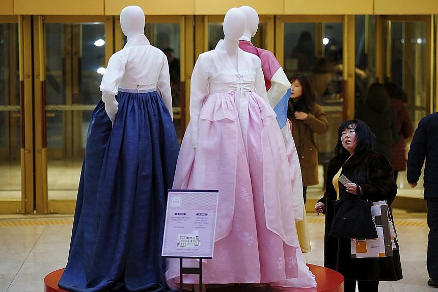 A Chinese tourist at a Seoul department store. Younger Chinese visitors to South Korea are opting to buy cheaper home-grown brands.