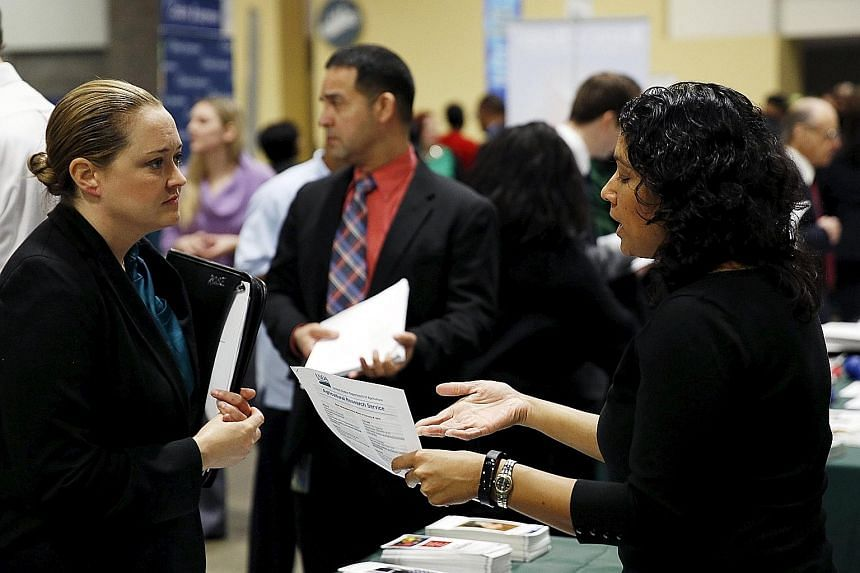A US Department of Agriculture worker (left) interviewing a job applicant at a US Chamber of Commerce Foundation military job fair in Washington last month. The moderation in hiring still leaves the job market on solid footing and shows companies are