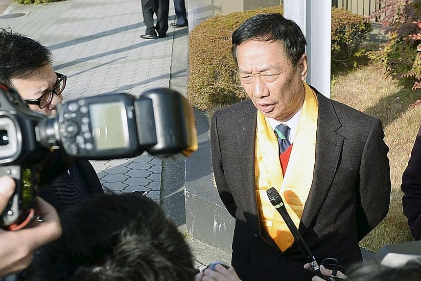 Mr Gou outside Sharp's headquarters in Osaka. He made a last-minute trip to Japan to persuade Sharp to accept his bid.