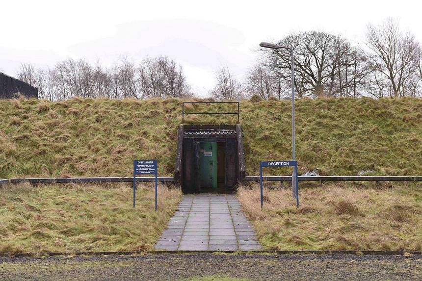 """The entrance to the heavily fortified underground bunker in Ballymena, Northern Ireland. It was built by the British government in 1987. A fresh air filter room in the nuclear bunker, which contains decontamination chambers, """"interlocking double blas"""