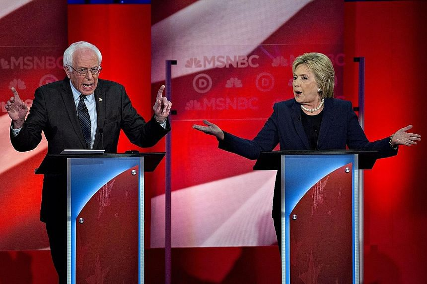 Democratic presidential candidates Bernie Sanders (above, left) and Hillary Clinton speaking at a debate at the University of New Hampshire on Thursday. Mrs Clinton faces an uphill battle in winning over younger voters, who polls show identify strong