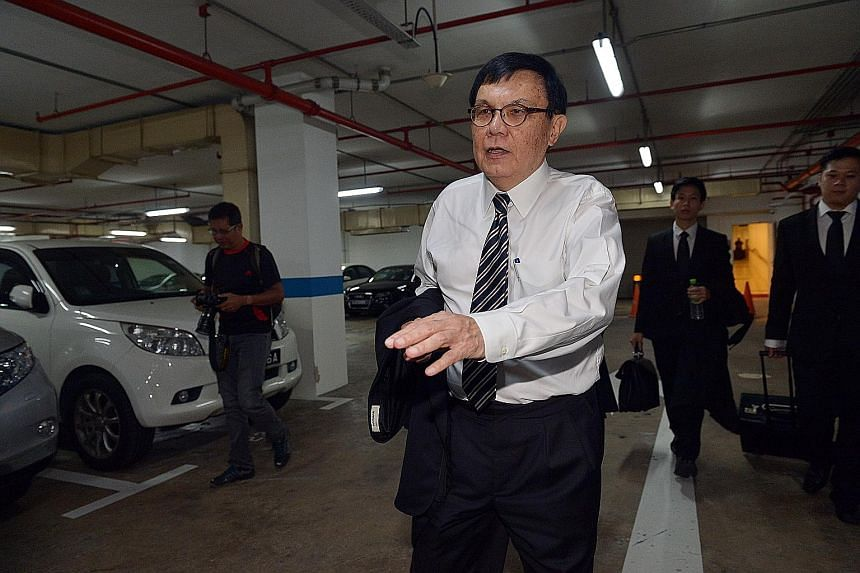 Senior Counsel Roderick Martin (centre) yesterday asked for the withdrawal of Mr Yak Yew Chee's application for the release of some of the money frozen as part of a probe over 1MDB. Mr Yak was not in court.