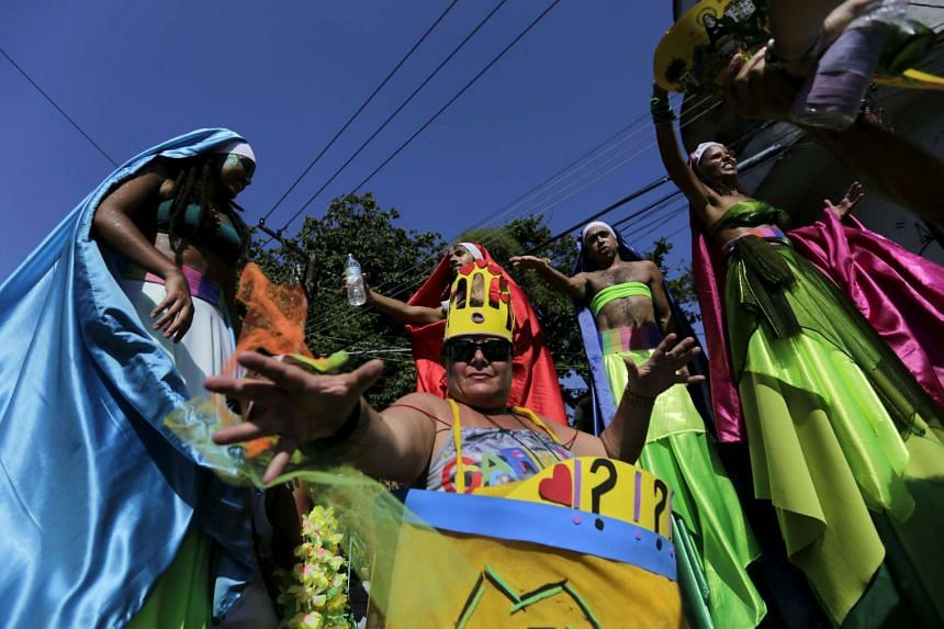 Revellers taking part in an annual block party known as Carmelitas, one of the many parties that take place during the Rio Carnival, on Feb 5.